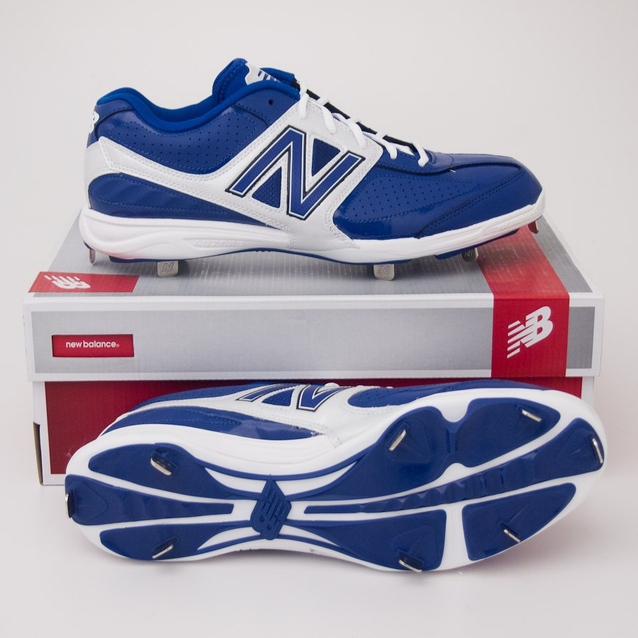 blue and white new balance cleats